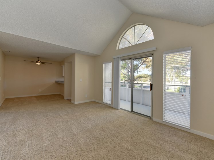 Luxury Apartment Community Living Room with Vaulted Ceilings and View of Private Patio