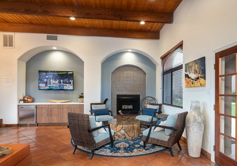 Clubroom with seating area, fireplace, and TV