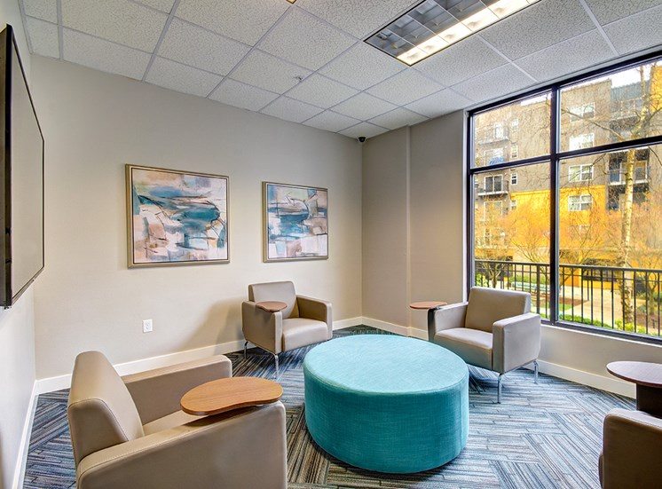 Community room with seating and TV