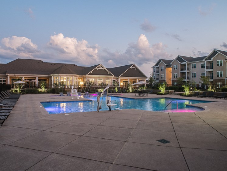 Sensational View Of The Pool Along With Relaxing Chairs at Abberly Square Apartment Homes, Waldorf, MD