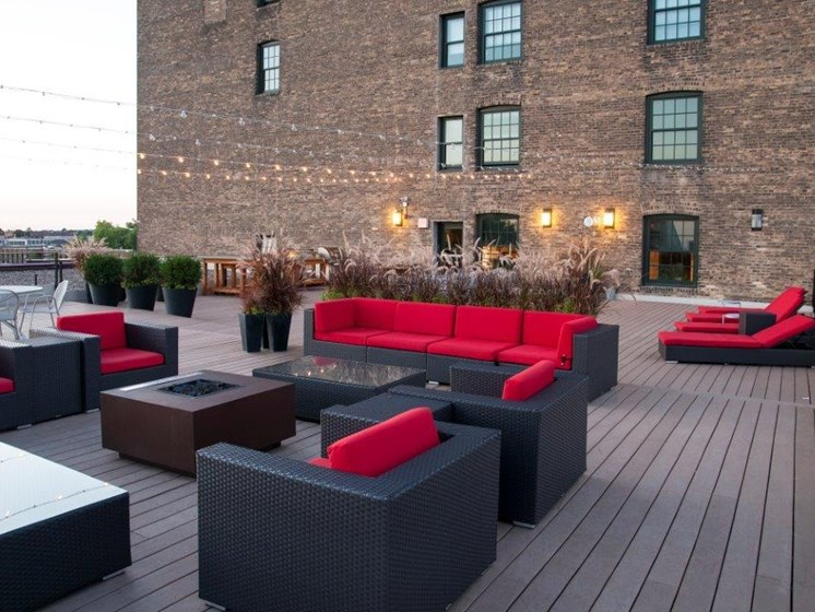 C&E Lofts Roof Top with Large Sectionals Around Fire Pits