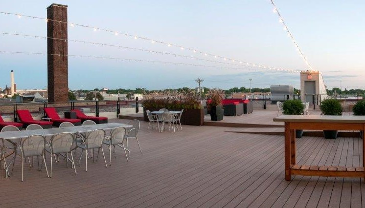 Large Open Rooftop Patio with Lounge Seating and Dining Tables at C&E Lofts