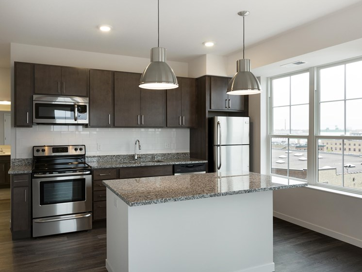 C&E Flats Kitchen with New Stainless Steel Appliances and Granite Counter tops