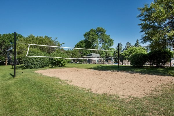 Play a game of sand volleyball!