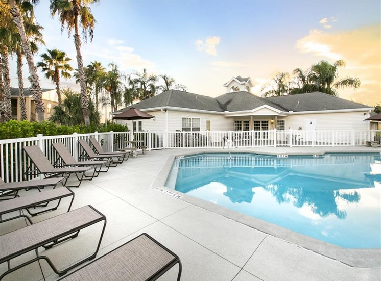 The Point at Naples Apartment Homes Naples, FL 34112 Sparkling Pool with lounge chairs