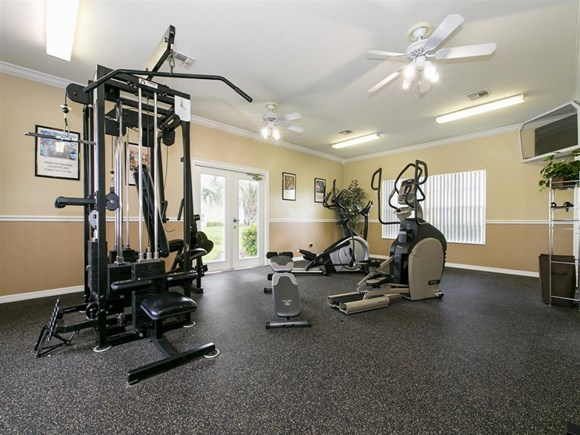 The Point at Naples Apartment Homes Naples, FL 34112 Fitness center with weight machine