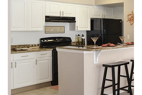The Point at Naples Apartment Homes Naples, FL 34112 upgraded kitchen and bathroom cabinets in select homes