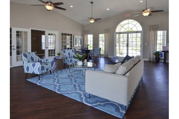 The Point at Naples Apartment Homes Naples, FL 34112 clubhouse with tvs and kitchen