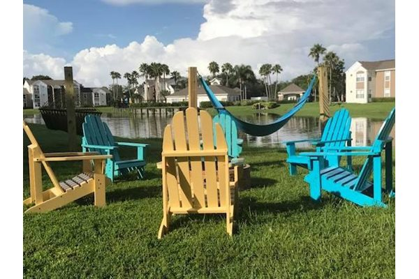 The Point at Naples Apartment Homes Naples, FL 34112 lounge area with fire pit and chairs