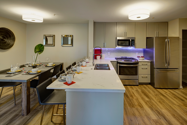 Chef Inspired Kitchen Islands with Chic Pendant Lighting at River Run at Naperville, Naperville, Illinois