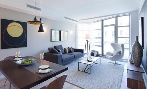 Spacious living room at 111 Kent Apartment Homes, NY, 11249