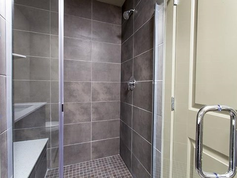 Frameless Showers with Benches at ALARA Union Station Apartment Homes, Denver, CO