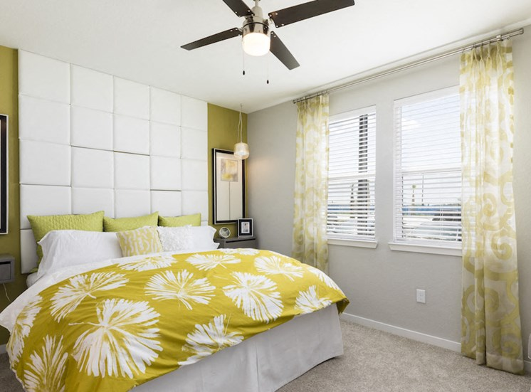 model bedroom with designer fan and large windows