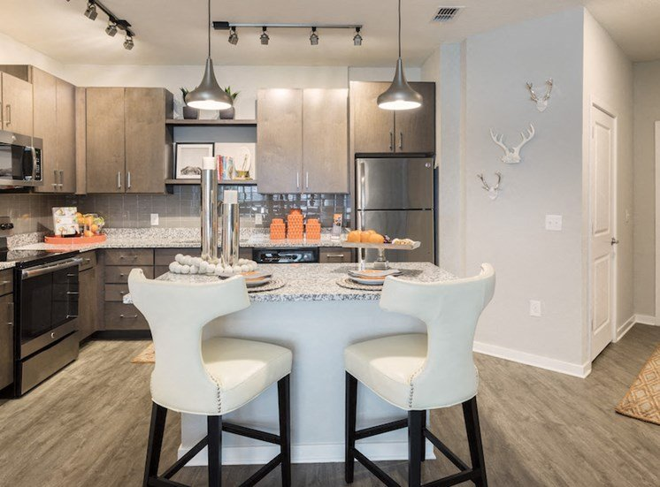 Ariel Apartments in Lake Nona, Orlando, FL 32827 stainless steel kitchen with pendant lighting