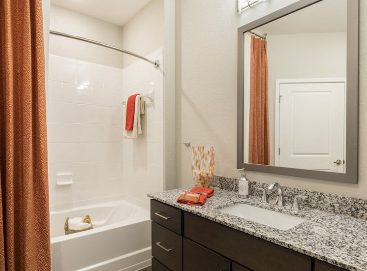 Spacious master bathroom with granite countertops