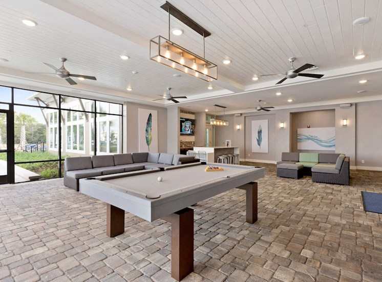 Ariel Apartments in Lake Nona, Orlando, FL 32827 amenity deck with billiards, seating, etc