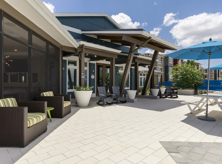 Ariel Apartments in Lake Nona, Orlando, FL 32827 Pool deck with outdoor furniture