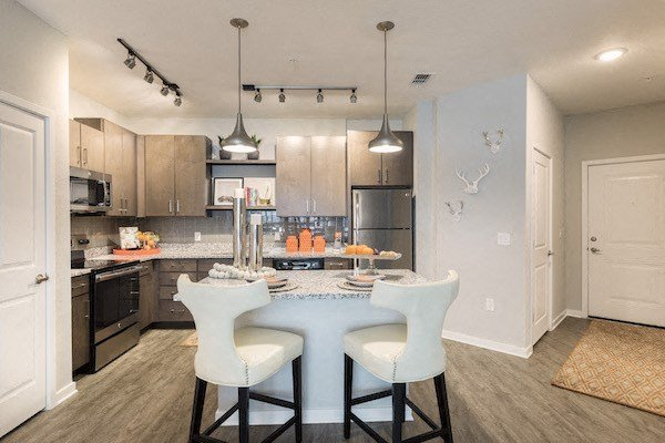 furnished model Gourmet style kitchen with eat-in island