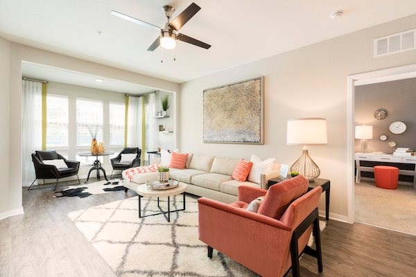 open living area in model apartment with furnishings