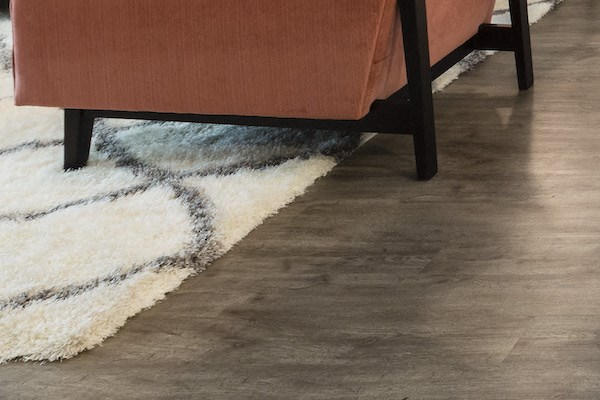 hardwood-inspired vinyl flooring in model apartment