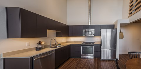 Modern Kitchen With Refrigerator at Ballard Lofts, 6450 24th Avenue, NW Seattle