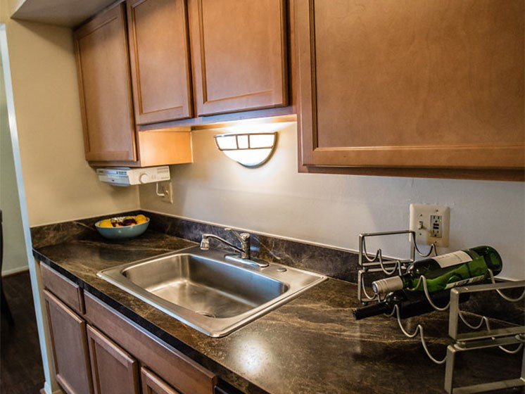 Wooden Kitchen Cabinets at Drawbridge Apartments East at 36420 Union Lake Road