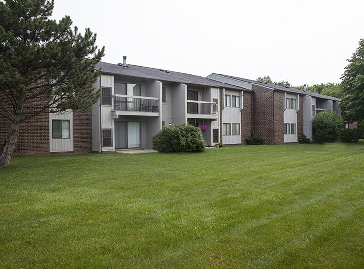 Courtyard and Building Exterior at Three Oaks Apartments in Michigan