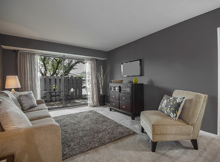 Spacious Living Room at Three Oaks Apartments in Troy, Michigan