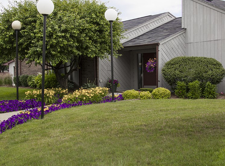 Beautifully Landscaped Courtyard and Building Exterior at Three Oaks Apartments in Troy, Michigan