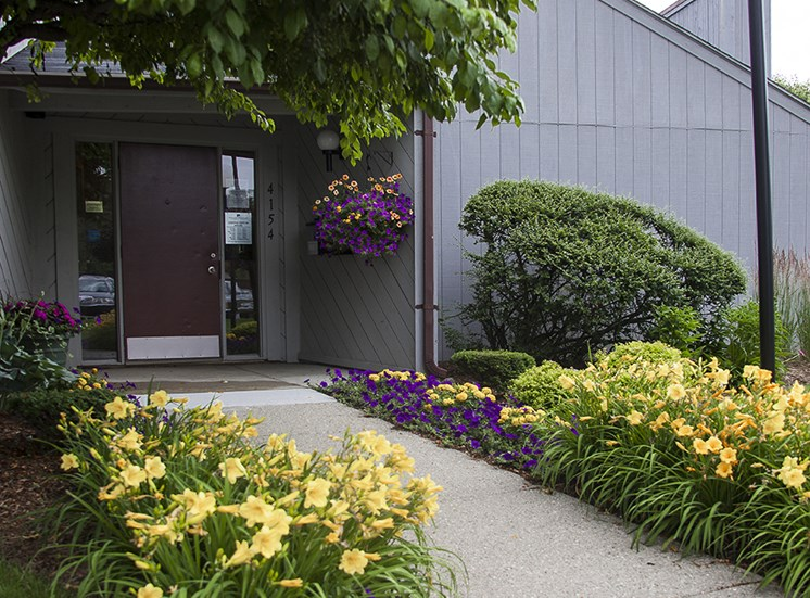 Entrance Walkway with Flowerbeds at Three Oaks Apartments, Michigan