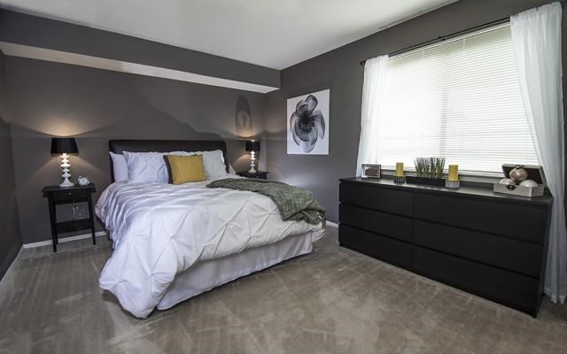 Spacious Bedroom at Three Oaks Apartments in Troy, Michigan