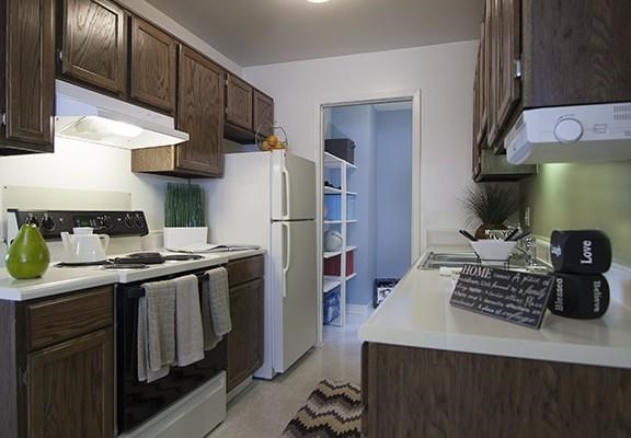Kitchen with Wood Cabinetry at Three Oaks Apartments at 4154 Three Oaks Boulevard