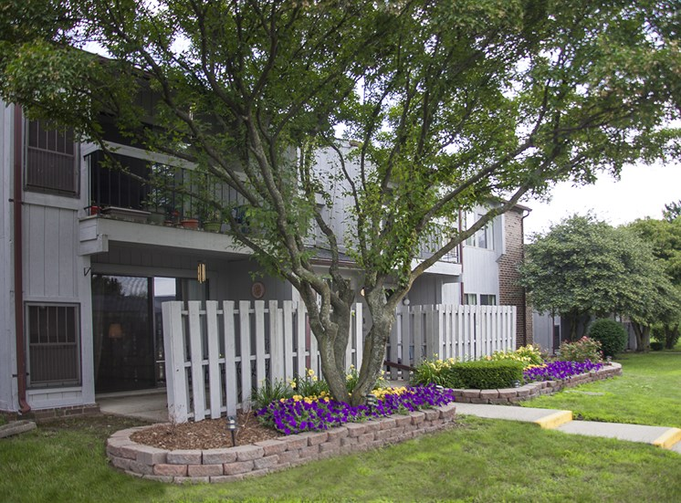 Patio and Flowerbeds at Three Oaks Apartments in Troy, MI