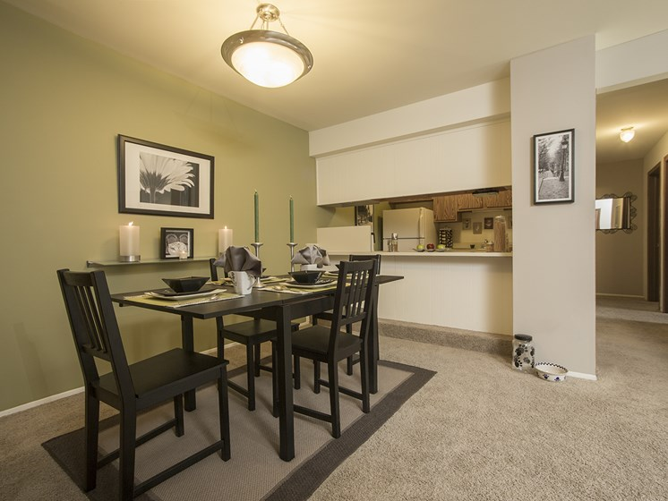 Dining room with ample space for entertaining at Woodland Villa Apartments in Westland, MI