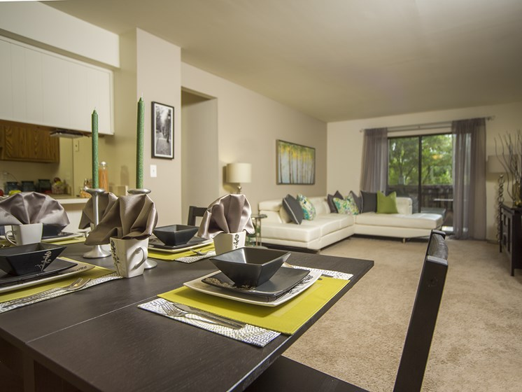 Living room and dining area at Woodland Villa Apartments in Michigan
