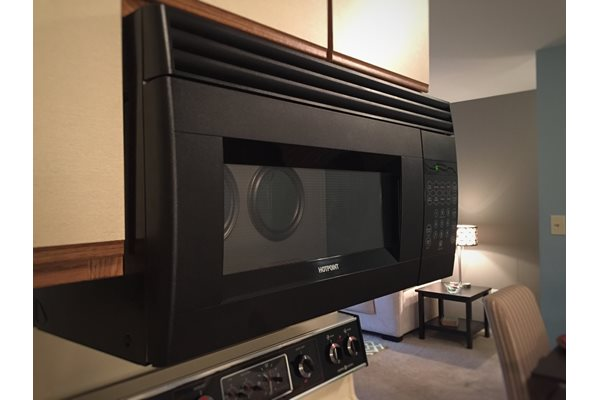 Cabinet mounted microwaves available at Woodland Villa Apartments, Michigan