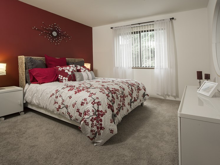 Spacious bedrooms large enough for King Size furniture at Woodland Villa Apartments in Westland, MI