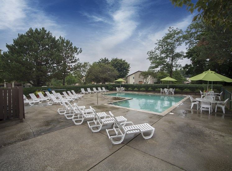 Heated pool (open April through October) with large sun deck at Woodland Villa Apartments in Westland, MI