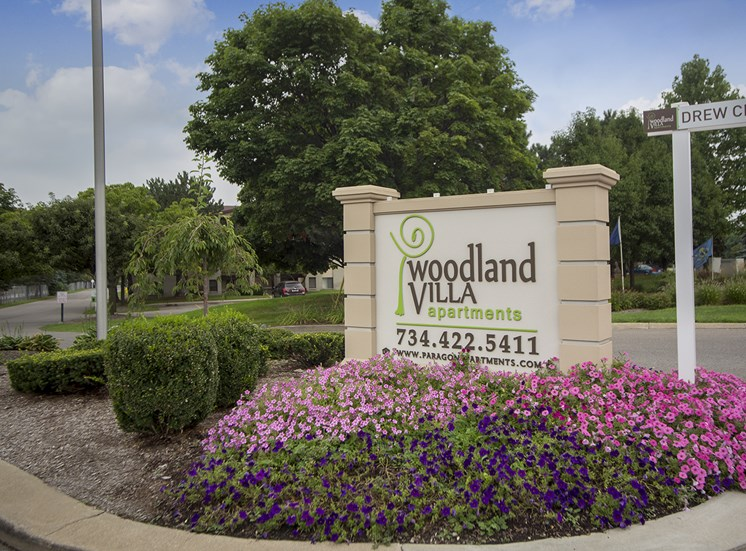 Entrance Sign at Woodland Villa Apartments at 7360 Drew Circle #9