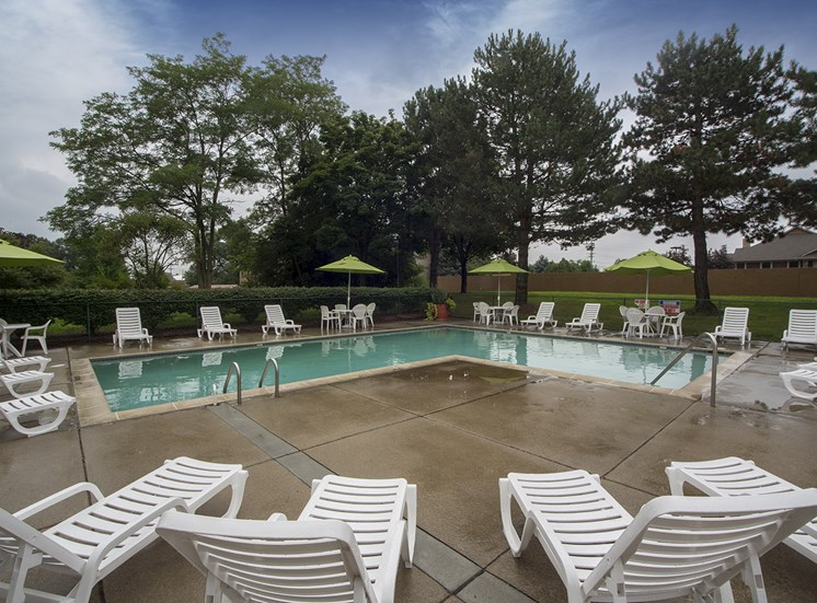 Heated pool (open April through October) with large sun deck at Woodland Villa Apartments in Westland, Michigan