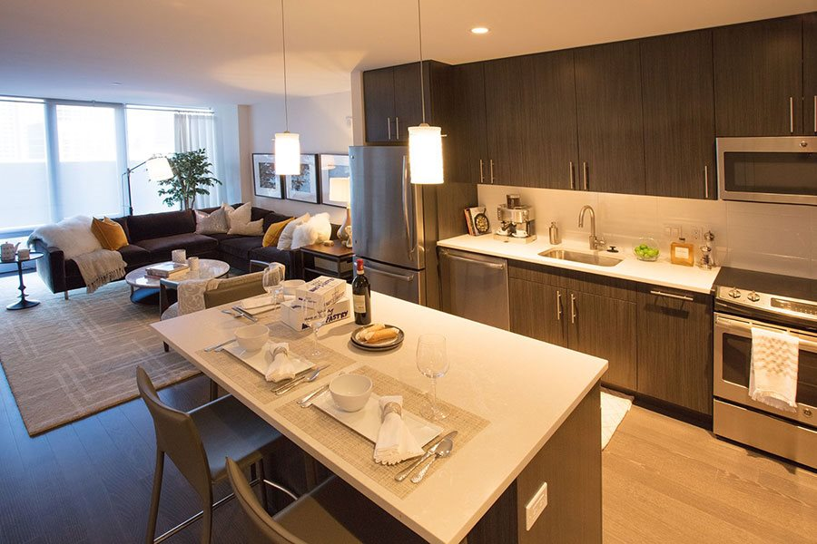 Fully Equipped Kitchens And Dining at The Benjamin Seaport Residences, Massachusetts, 02210