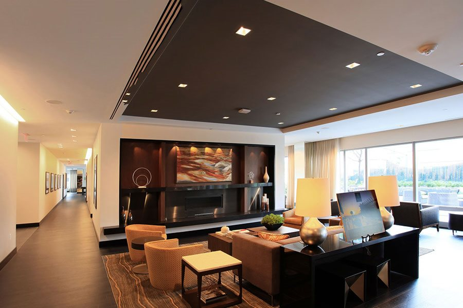 Lounge Area With Fireplace at The Benjamin Seaport Residences, Boston, 02210