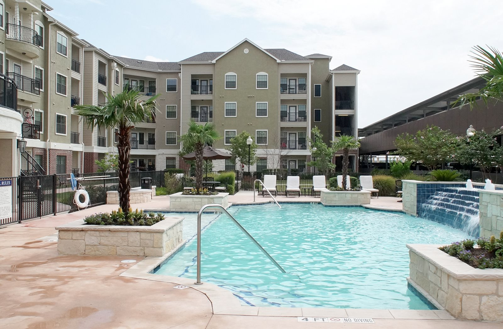 pool with lounge chairs Creekside Vue Apt Living l New Braunfels, TX