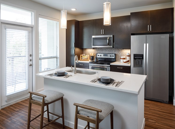 Kitchen with Rich Shaker Style Cabinetry and Breakfast bar at Ascent Cresta Bella, San Antonio, TX 78256