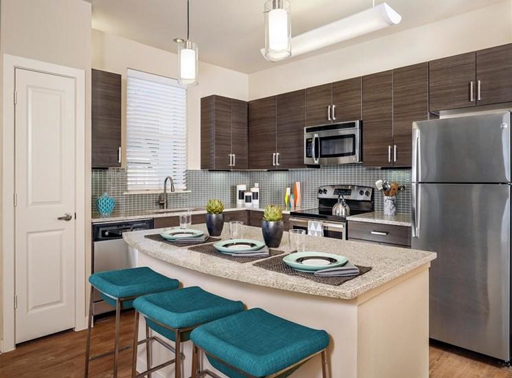 Kitchen with Breakfast Bar at Thirty Oaks, San Antonio,Texas