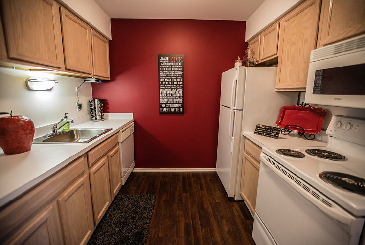 Kitchen with Wood Cabinetry at Prentiss Pointe Apartments, Michigan