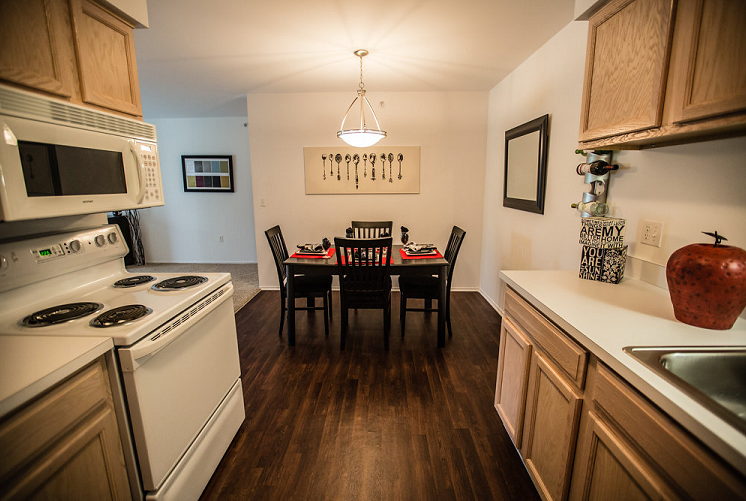 Kitchen with Wood Cabinetry at Prentiss Pointe Apartments, Harrison Township, MI