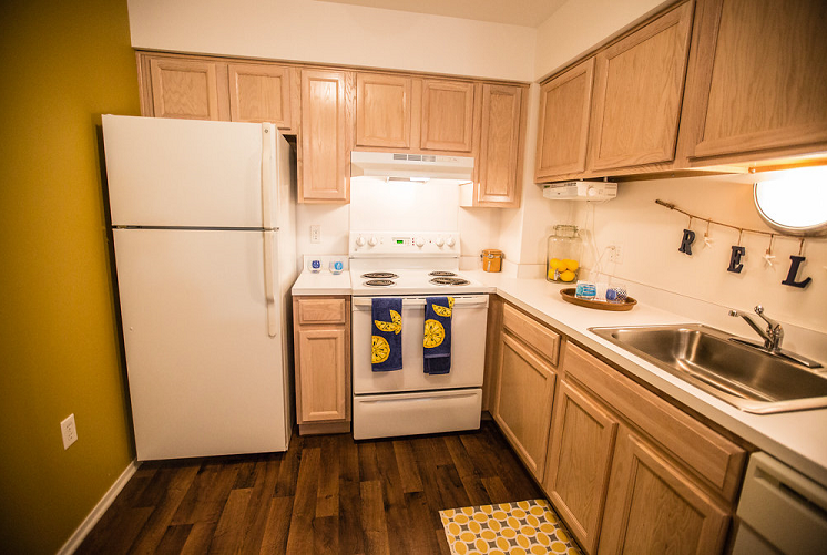 Kitchen with Wood Cabinetry at Prentiss Pointe Apartments, MI