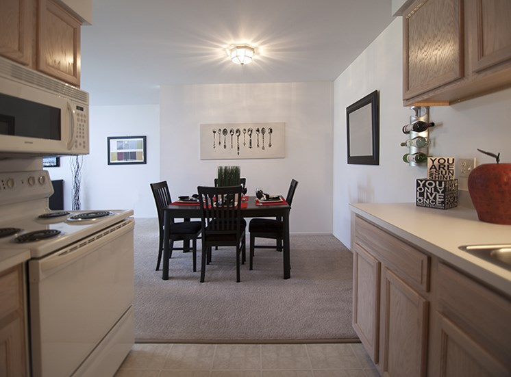 Kitchen and Dining Room at Prentiss Pointe Apartments in Harrison Township, MI