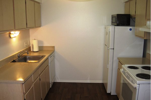Kitchen in Short Term Furnished Unit Available at Dover Hills Apartments  in Kalamazoo  MI. Dover Hills Apartments  4520 Dover Hills Drive  Kalamazoo  MI